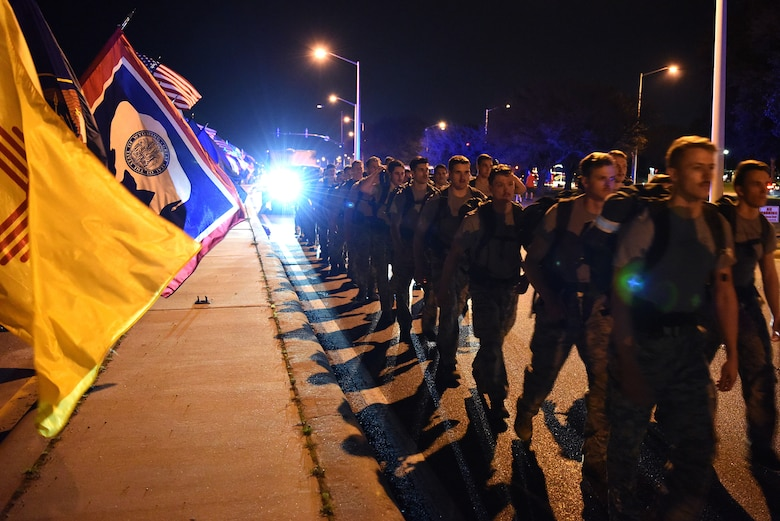 Airmen from the 81st Training Group hold the 50 flags while the 352nd Battlefield Airmen Training Squadron Detachment 1, join a team of Special Tactics Airmen ruck marching through Biloxi, Mississippi March 1, 2019. Twenty Special Tactics Airmen ruck from Medina Annex at Lackland Air Force Base, Texas, to Hurlburt Field, Florida, to pay tribute to Staff Sgt. Dylan J. Elchin, who was killed in Afghanistan on Nov. 27, 2018, and 19 other Special Tactics Airmen who have been killed in action since 9/11. The ruck march takes ST members across five states and 830 miles. (U.S. Air Force photo by Senior Airman Suzie Plotnikov)