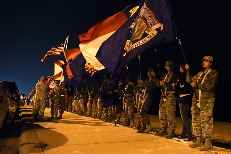 Airmen from the 81st Training Group hold the 50 flags during the Sepcial Tactics Memorial Ruck March in Biloxi, Mississippi, March 1, 2019. Twenty Special Tactics Airmen ruck from Medina Annex at Lackland Air Force Base, Texas, to Hurlburt Field, Florida, to pay tribute to Staff Sgt. Dylan J. Elchin, who was killed in Afghanistan on Nov. 27, 2018, and 19 other Special Tactics Airmen who have been killed in action since 9/11. The ruck march takes ST members across five states and 830 miles. (U.S. Air Force photo by Senior Airman Suzie Plotnikov)
