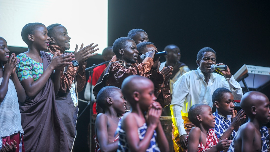 Members of the LEAF Junior Troupe sing as other members of the group perform a dance during a Tour du Rwanda concert in Kigali, Rwanda, March 2, 2019.