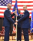 (Left to right) Col. Phil Heseltine, 931st Air Refueling Wing commander, hands the guidon from Capt. Craig Van Praag incoming  931st Force Support Squadron commander, during an official change of command ceremony March 2, 2019, McConnell Air Force Base, Kan.  Van Praag will be responsible for a military and civilian team in nine different Air Force specialties including personnel, education, training, manpower, communications and information, services and quality of life programs.  (U.S. Air Force photo by Tech. Sgt. Abigail Klein)