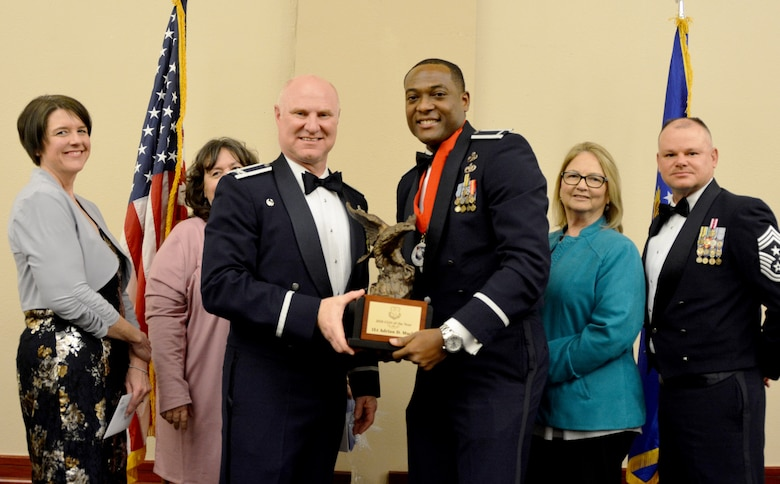 Col. Miles Heaslip, 507th Air Refueling Wing commander, and Chief Master Sgt. David Dickson, 507th ARW command chief, along with wing community partners, present the 507th ARW Company Grade Officer of the Year award to 1st Lt. Adrian Mack, 507th Aircraft Maintenance Squadron, March 2, 2019, in Midwest City, Oklahoma. (U.S. Air Force photo by Maj. Jon Quinlan)