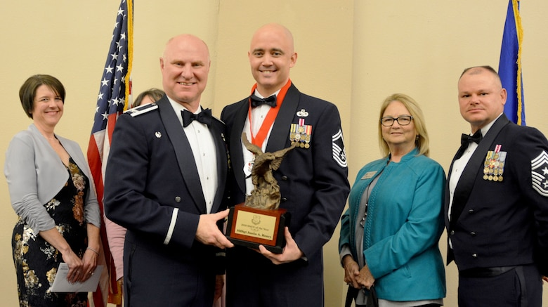 Col. Miles Heaslip, 507th Air Refueling Wing commander, and Chief Master Sgt. David Dickson, 507th ARW command chief, along with wing community partners, present the 2018 507th ARW Senior Noncommissioned Officer of the Year award to Senior Master Sgt. Justin Henry, 507th Aircraft Maintenance Squadron, March 2, 2019, in Midwest City, Oklahoma. (U.S. Air Force photo by Maj. Jon Quinlan)