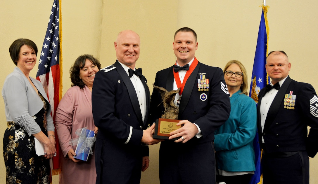 Col. Miles Heaslip, 507th Air Refueling Wing commander, and Chief Master Sgt. David Dickson, 507th ARW command chief, along with community partners, present the 2018 507th ARW Noncommissioned Officer of the Year award to Tech. Sgt. Benjamin Alexander, 730th Air Mobility Training Squadron, March 2, 2019, in Midwest City, Oklahoma. (U.S. Air Force photo by Maj. Jon Quinlan)