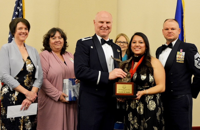 Col. Miles Heaslip, 507th Air Refueling Wing commander, and Chief Master Sgt. David Dickson, 507th ARW command chief, along with wing community partners, present the 507th ARW Spouse of the Year award to Mrs. Jennifer Smith, March 2, 2019, in Midwest City, Oklahoma. (U.S. Air Force photo by Maj. Jon Quinlan)