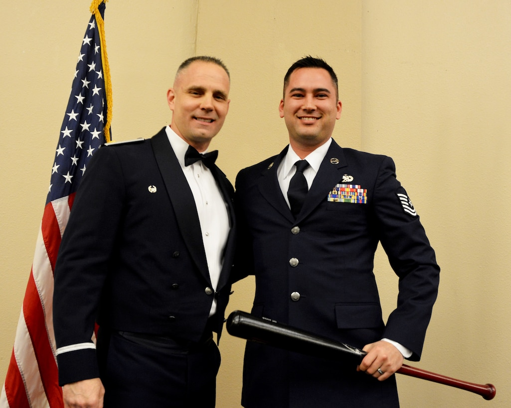 Maj. Randy Starnes, 507th Aircraft Maintenance Squadron commander, presents the 2018 507th AMXS Heavy Hitter Award to Tech. Sgt. Michael Dunning March 2, 2019, Midwest City, Oklahoma. (U.S. Air Force photo by Maj. Jon Quinlan)