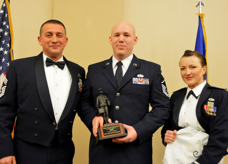 Chief Master Sgt. Richard Stull, 507th Maintenance Squadron superintendent, and Maj. Melissa Jones, 507th MXS commander, present the 2018 507th Maintenance Squadron MVP of the Year award to Master Sgt. Matthew Pearsall, March 2, 2019, in Midwest City, Oklahoma. (U.S. Air Force photo by Maj. Jon Quinlan)
