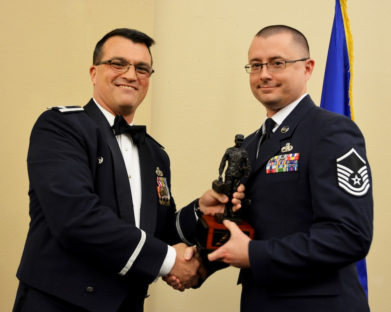 Lt. Col. Bradley Garcia, 507th Maintenance Group deputy commander, presents the 2018 507th MXG MVP of the Year Award to Master Sgt. Justin Watson March 2, 2019, Midwest City, Oklahoma. (U.S. Air Force photo by Maj. Jon Quinlan)