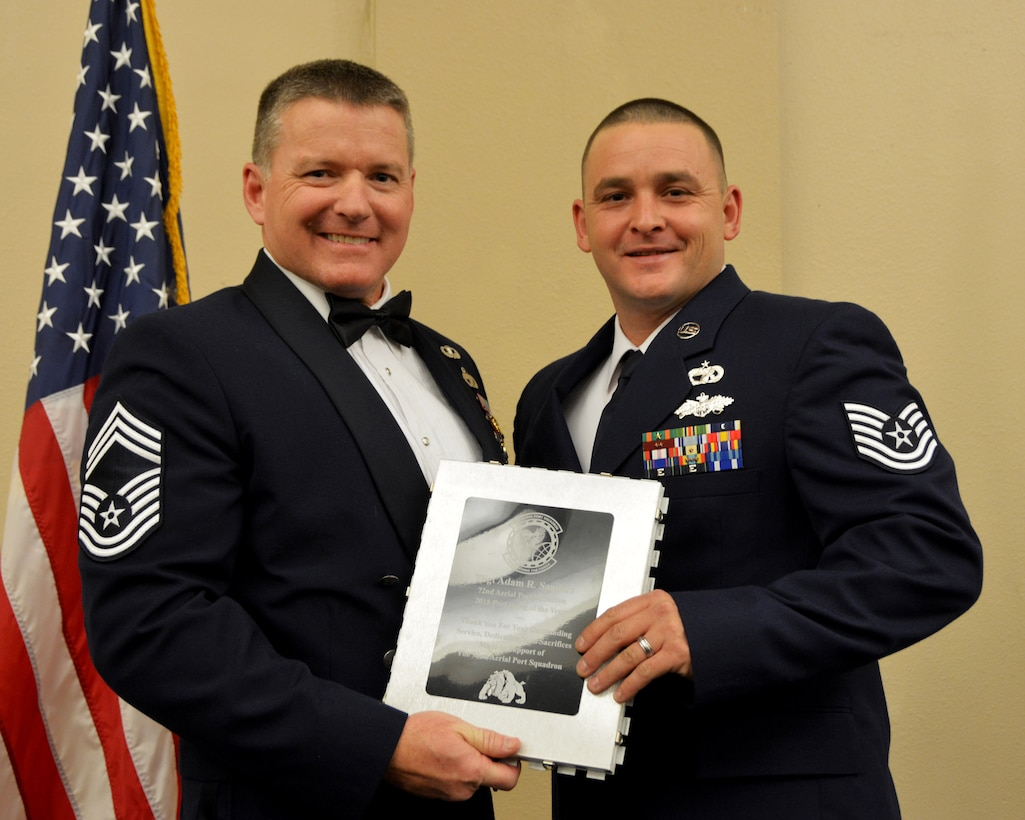 Chief Master Sgt. Michael Knight, 72nd Aerial Port Squadron, presents the 2018 72nd APS Port Dawg of the Year award for outstanding performance to Tech. Sgt. Adam Sanders March 2, 2019, in Midwest City, Oklahoma. (U.S. Air Force photo by Maj. Jon Quinlan)