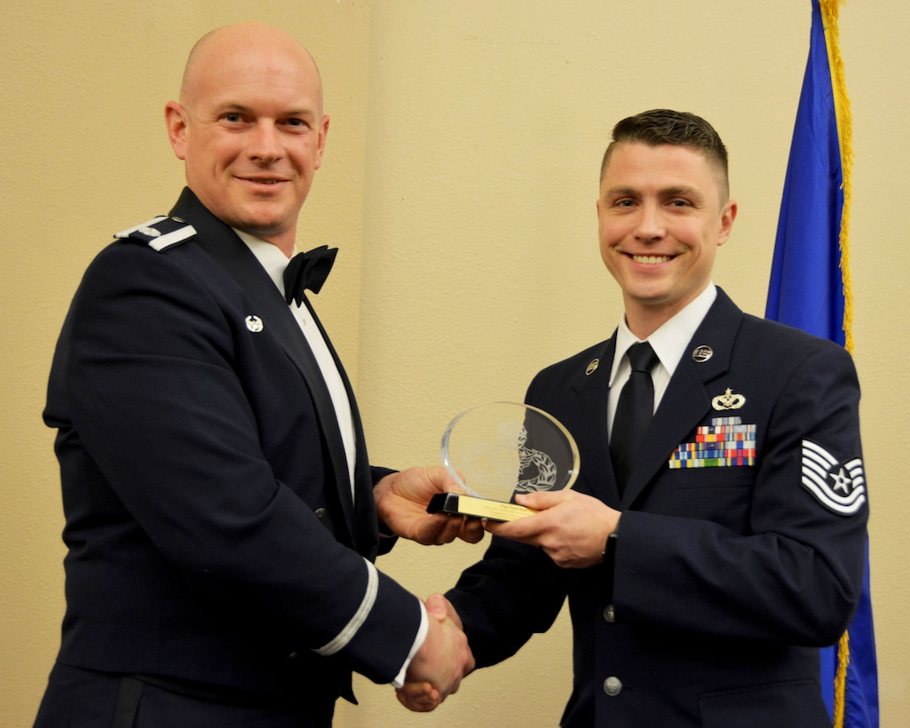 Lt. Col. Dustin Born, 507th Civil Engineer Squadron commander, presents the 2018 507th CES Civil Engineer of the Year award for outstanding performance to Tech. Sgt. David Reed March 2, 2019, in Midwest City, Oklahoma. (U.S. Air Force photo by Maj. Jon Quinlan)