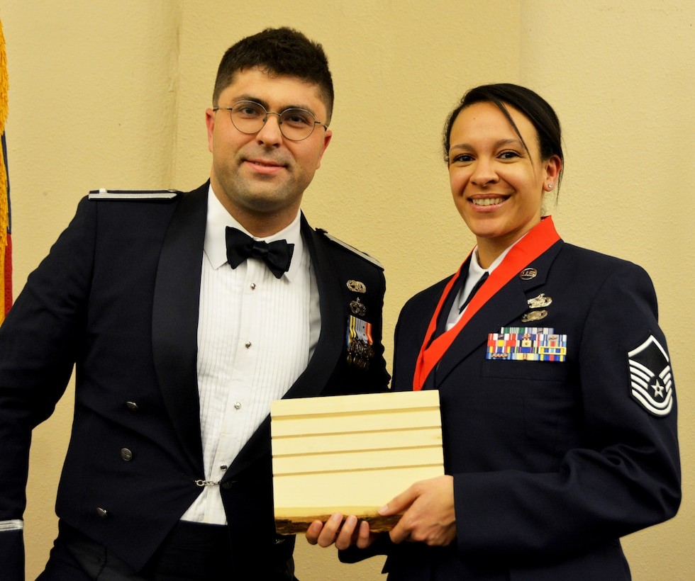 1st Lt. Jose Barreto, 507th Logistics Readiness Squadron, presents the 2018 507th LRS Logistics Professional of the Year award for outstanding performance to Master Sgt. Kayla Cuffie March 2, 2019, Midwest City, Oklahoma. (U.S. Air Force photo by Maj. Jon Quinlan)