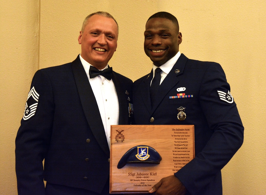Chief Master Sgt. Nickolas Swainston, 507th Security Forces Squadron, presents the 2018 507th SFS Defender of the Year award for outstanding performance to Staff Sgt. Jaboree Kiel March 2, 2019, in Midwest City, Oklahoma. (U.S. Air Force photo by Maj. Jon Quinlan)
