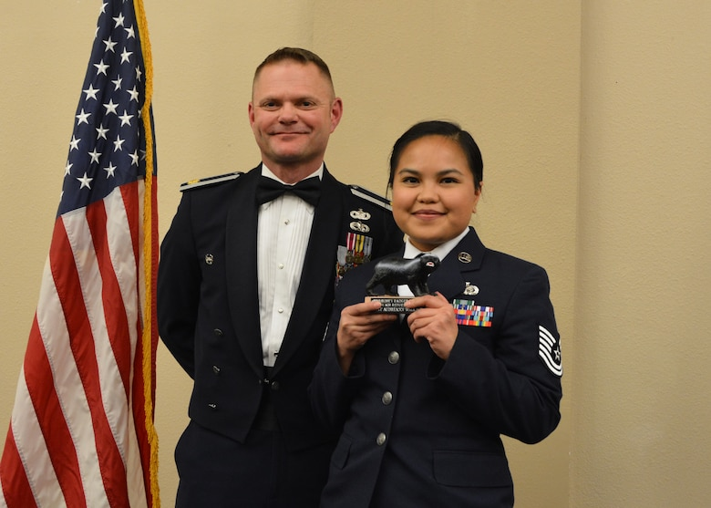Maj. Patrick Mitchell, 507th Air Refueling Wing executive officer, presents the 2018 507th ARW Wing Staff Honey Badger Trophy for outstanding performance to Tech. Sgt. Audreann Wallace March 2, 2019, in Midwest City, Oklahoma. (U.S. Air Force photo by Maj. Jon Quinlan)