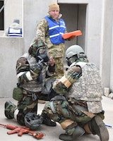 Reserve Citizen Airmen of the 931st Air Refueling Wing inspect the seal on each other's gas masks during in an Annual Readiness Assessment March 2, 2019, McConnell Air Force Base, Kan. The exercise consisted of deployment and redeployment of troops to and from an assigned location, the performance of self-aid and buddy care (SABC), contamination avoidance, warning and alarm signals, reporting, and the performance of protective postures (MOPP).  (U.S. Air Force photo by Tech. Sgt. Abigail Klein)