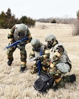 """Reserve Citizen Airmen of the 931st Air Refueling Wing sweep the field for """"land mines"""" during in an Annual Readiness Assessment March 2, 2019, McConnell Air Force Base, Kan. The exercise consisted of deployment and redeployment of troops to and from an assigned location, the performance of self-aid and buddy care (SABC), contamination avoidance, warning and alarm signals, reporting, and the performance of protective postures (MOPP).  (U.S. Air Force photo by Tech. Sgt. Abigail Klein)"""