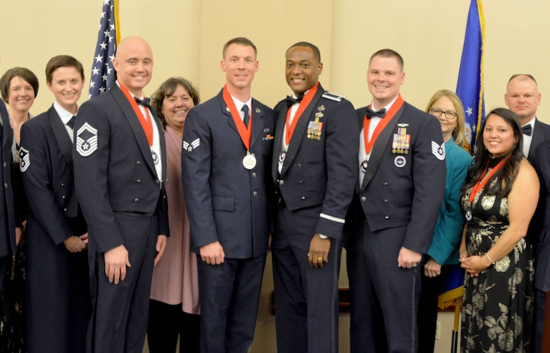 The 2018 507th Air Refueling Wing annual award winners pose for a photo March 2, 2019, at the Sheraton Reed Conference Center in Midwest City, Oklahoma. Front row: Tasha Windisch, Tinker Federal Credit Union; Master Sgt. Lindsay Newton; Senior Master Sgt. Justin Henry; Jan Davis, Moore Chamber of Commerce and TFCU; Senior Airman Preston Baker, 1st Lt. Adrian Mack; Tech. Sgt. Benjamin Alexander; Kathy Gillette, Moore Chamber of Commerce; Jennifer Smith, and Chief Master Sgt. David Dickson, 507th ARW command chief. (U.S. Air Force photo Maj. Jon Quinlan)