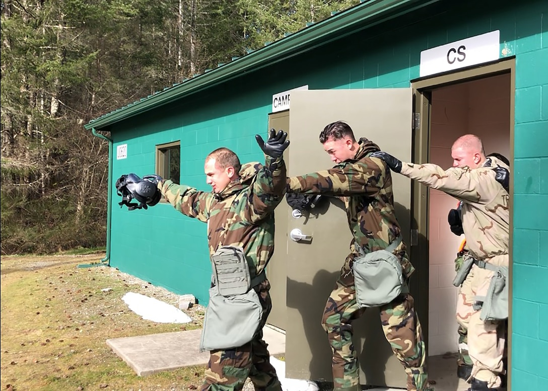 Members of Team McChord participate in the Mask Confidence Course