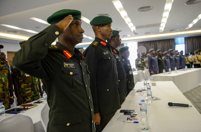 Participants in the African Partnership Flight Rwanda render proper customs and courtesies during the opening ceremony in Kigali, Rwanda, March 4, 2019. Hosted by the Rwanda Defence Force and U.S. Air Forces Africa, APF Rwanda's focus is on sharing best practices for flight, ground, and weapon safety. (U.S. Air Force photo by Tech. Sgt. Timothy Moore)