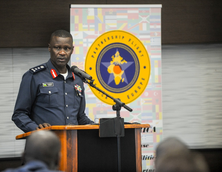 Rwanda Air Force Air Chief, Maj. Gen. Charles Karamba gives remarks during the African Partnership Flight Rwanda opening ceremony in Kigali, Rwanda, March 4, 2019. The APF program is intended to build strong, transparent partnerships that enhance regional stability and security. APF Rwanda's focus is on sharing best practices for flight, ground, and weapon safety. (U.S. Air Force photo by Tech. Sgt. Timothy Moore)