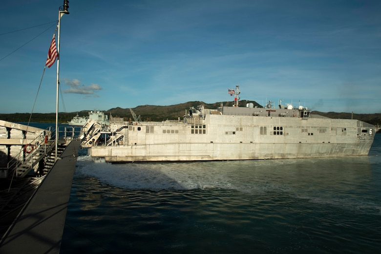 SANTA RITA, Guam (March 4, 2019) The Military Sealift Command (MSC) expeditionary fast transport ship USNS Brunswick (T-EPF 6) departs Naval Base Guam, passing the MSC expeditionary fast transport ship USNS Fall River (T-EPF 4) and marking the start of Pacific Partnership 2019. Pacific Partnership, now in its 14th iteration, is the largest annual multinational humanitarian assistance and disaster relief preparedness mission conducted in the Indo-Pacific. Each year the mission team works collectively with host and partner nations to enhance regional interoperability and disaster response capabilities, increase security and stability in the region, and foster new and enduring friendships in the Indo-Pacific.