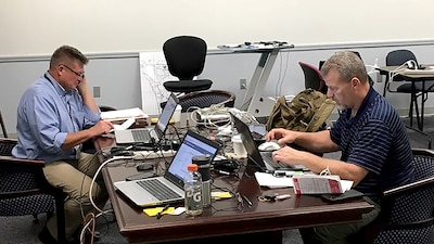 Deputy commander of Task Force Atlantic, Robert Bednarcik, and Operations Officer Robert Hays work command and control functions while forward deployed to Gunter Annex of Maxwell Air Force Base in Montgomery, Alabama, during Hurricane Florence.