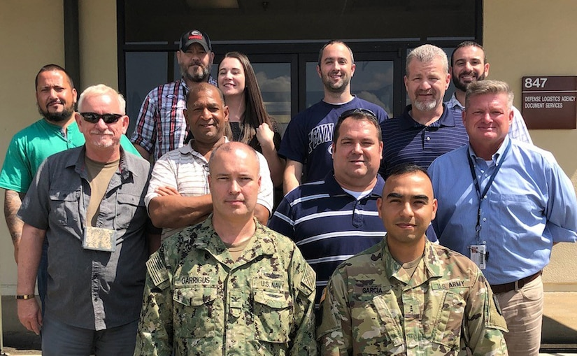 DLA Rapid Deployment Team White, led by Navy Capt. Mark Garrigus (front left), poses for a picture at Maxwell Air Force Base, Alabama, while deployed in support of Hurricane Florence.