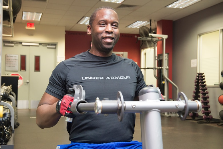 Robert Jackson, mechanical engineer and chairperson of Huntsville Center's Wellness Committee, targets his trapezius muscles during a workout in the Center's newly opened gym.