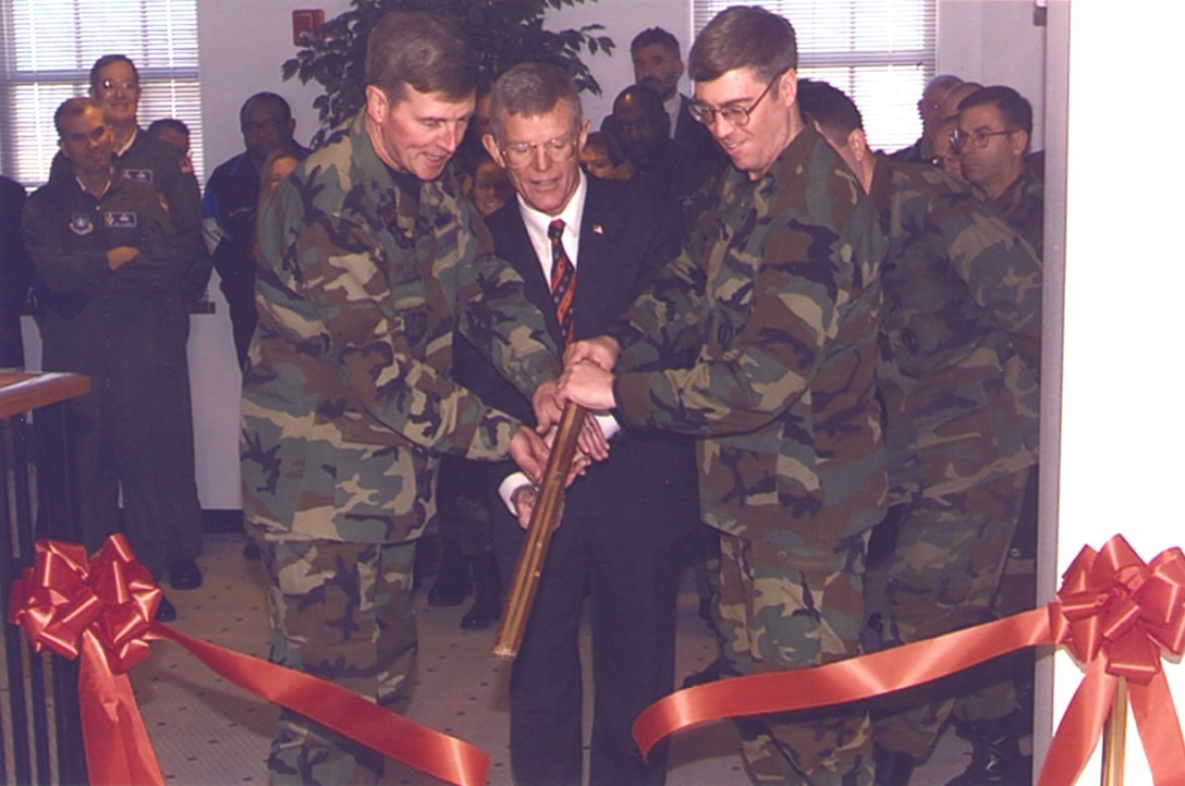 In a historical archive photo dating back to Mar. 26, 2002, Maj. Gen. Robert McMahon, 20th Air Force Commander, Maj. Gen. (retired) Thomas Neary, 20th Air Force Commander, and Col Shearer, 90th Missile Wing Commander cut the ribbon to open the ICBM Center of Excellence on F. E. Warren AFB, Wyo. (Courtesy photo)