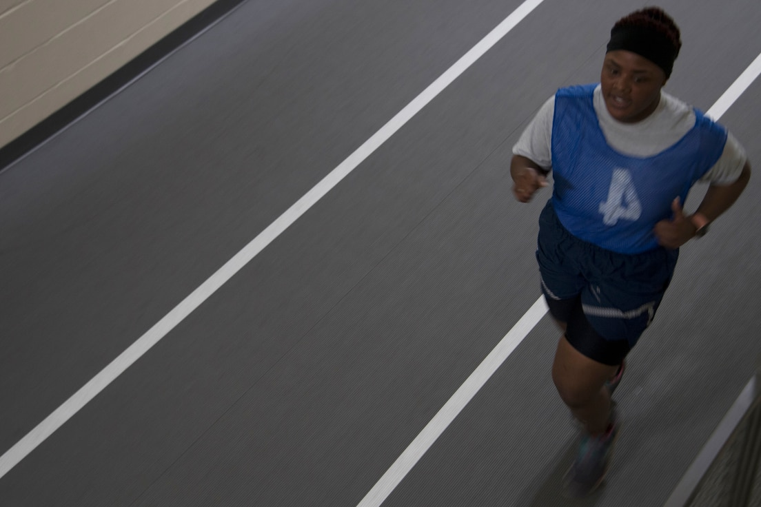 Senior Airman Decaqunita Forte, assigned to the 307th Medical Squadron, completes the run portion of the Air Force physical fitness assessment at Barksdale Air Force Base, Louisiana, February 10, 2019. Physical fitness assessments are one  tool used in measuring an Airman's overall resiliency. (U.S. Air Force photo by Airman 1st Class Maxwell Daigle)