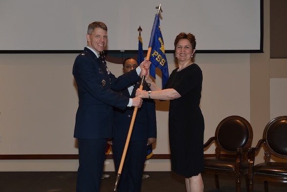 Col. Trevor Wentlandt, 460th Mission Support Group commander, hands the guidon to Debbie E. Southee, incoming 460th Force Support Squadron director, Feb. 28, 2019, on Buckley Air Force Base, Colorado. The changing of the guidon symbolizes the official change of responsibility. (U.S. Air Force photo by Airman 1st Class Jake Deatherage)