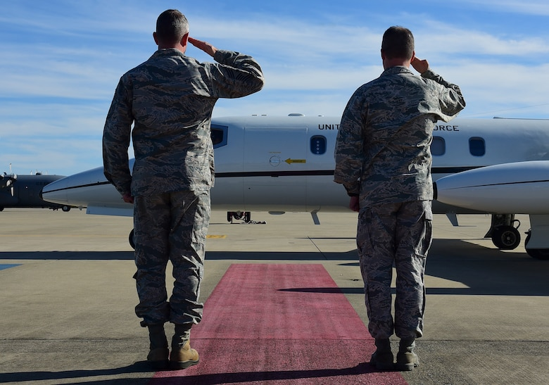 From right, Col. Donn Yates, 4th Fighter Wing commander, and Chief Master Sgt. Stephen Cornelius, 4th FW command chief, salute the aircraft of Gen. Mike Holmes, commander of Air Combat Command, Feb. 25, 2019, at Seymour Johnson Air Force Base, North Carolina. Holmes visited the base to talk with Airmen and learn about new innovations from members of Team Seymour. (U.S. Air Force photo by Senior Airman Kenneth Boyton)