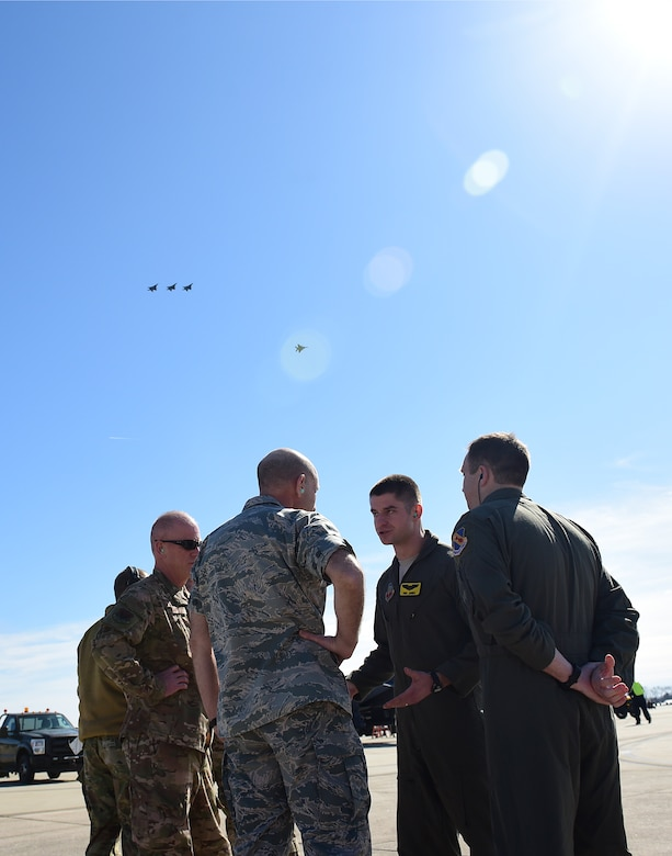 Gen. Mike Holmes, commander of Air Combat Command, center, and Chief Master Sgt. Frank Batten, command chief of ACC, left, talk with pilots from the 336th Fighter Squadron, Feb. 26, 2019, at Seymour Johnson Air Force Base, North Carolina. During their visit, Holmes and Batten visited several shops and answered questions from Airmen regarding the Air Force, new innovations, and the future of the Air Force. (U.S. Air Force photo by Senior Airman Kenneth Boyton)