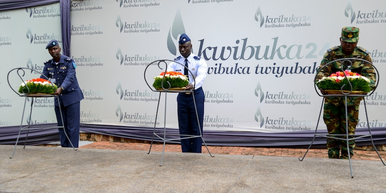 Rwanda Air Force Capt. Emmanuel Rutebuka, left, U.S. Air Force Col. Stephen Hughes, center, and Ghana Air Force Squadron Leader Ishmael Ansah lay down wreaths during a ceremony at the Kigali Genocide Memorial in Kigali, Rwanda, March 4, 2019. The wreath laying ceremony was part of a cultural visit for the African Partnership Flight Rwanda. (U.S. Air Force photo by Tech. Sgt. Timothy Moore)