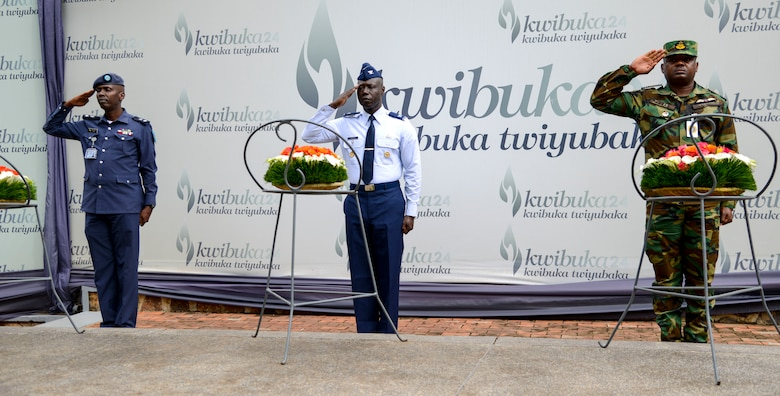 Rwanda Air Force Capt. Emmanuel Rutebuka, left, U.S. Air Force Col. Stephen Hughes, center, and Ghana Air Force Squadron Leader Ishmael Ansah render salutes during a wreath laying ceremony at the Kigali Genocide Memorial in Kigali, Rwanda, March 4, 2019. The ceremony was part of a cultural visit for the African Partnership Flight Rwanda. (U.S. Air Force photo by Tech. Sgt. Timothy Moore)