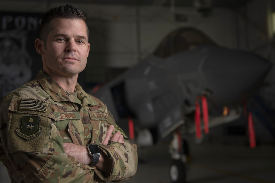 U.S. Air Force Chief Master Sgt. Tony Jenkins, 33rd Operations Group superintendent, stands in front of an F-35A Lightning II assigned to the 33rd Fighter Wing Feb. 19, 2019, at Eglin Air Force Base, Fla. Jenkins was given a second chance early on in his career that shaped his future as an Airman and leader. Twenty years after that second chance at success, he has been selected to serve in the capacity of command chief. (U.S. Air Force photo by Staff Sgt. Peter Thompson)