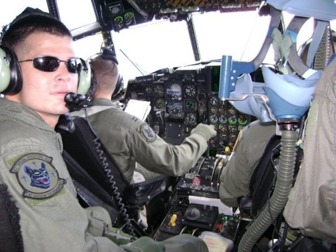 U.S. Air Force Chief Master Sgt. Tony Jenkins, 33rd Operations Group superintendent, pictured as a Staff Sgt., sits in the flight deck of an MC-130 during a local training sortie May 2005, near Japan. After spending several years as an aircraft communication and navigation systems specialist, Jenkins cross-trained to become a flight engineer. (Courtesy photo)