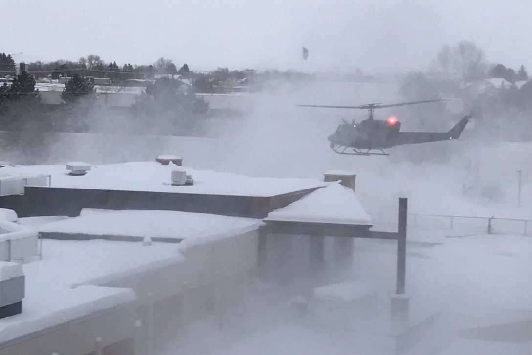 Aircrew from the 40th Helicopter Squadron begin to land at Benefis Hospital in Great Falls after a successful search and rescue March 1, 2019.