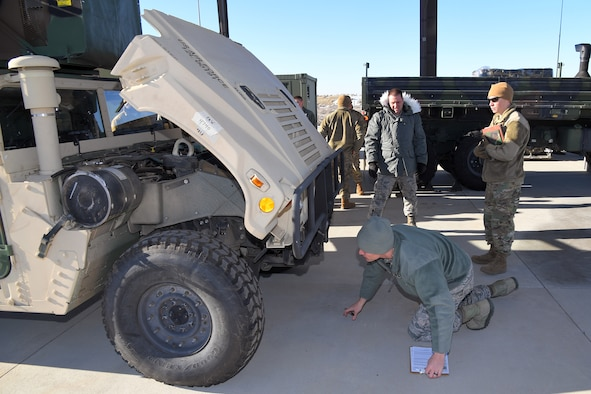 Master Sgt. Andrew Bowman (left) and Staff Sgt. Zachary Witt, both 729th Air Control Squadron, perform a joint technical inspection for vehicles during a readiness exercise Jan. 31 2019, at Hill Air Force Base, Utah. (U.S. Air Force photo by Todd Cromar)