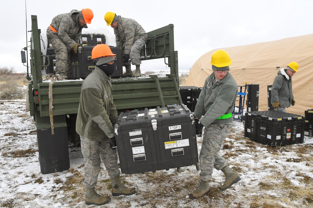 Airmen with the 729th Air Control Squadron unload equipment from vehicles Feb. 5, 2019, during a readiness exercise at Hill Air Force Base, Utah. The evolution was part of an exercise to mobilize and set up a deployed radar location and control reporting center. (U.S. Air Force photo by Todd Cromar)