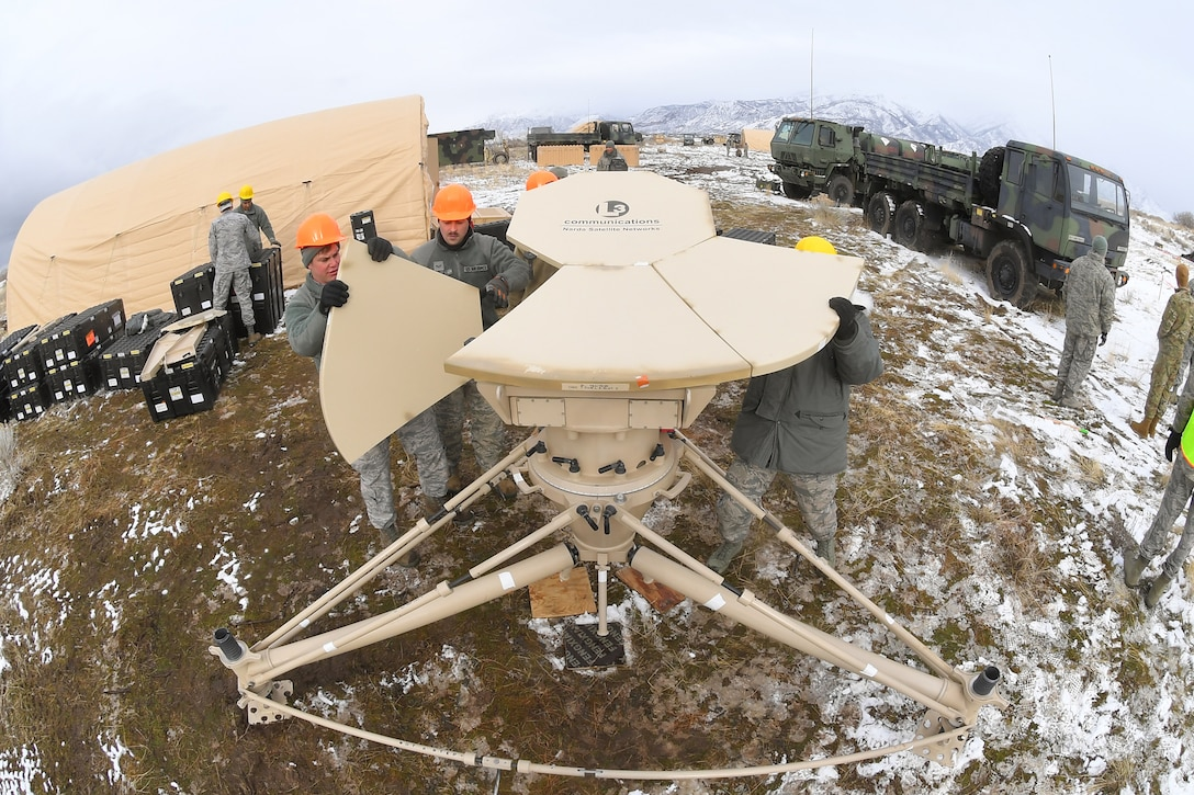 Airmen with the 729th Air Control Squadron set up a communications antenna Feb. 5, 2019, during a readiness exercise at Hill Air Force Base, Utah. The evolution was part of an exercise to mobilize and set up a deployed radar location and control reporting center. (U.S. Air Force photo by Todd Cromar)