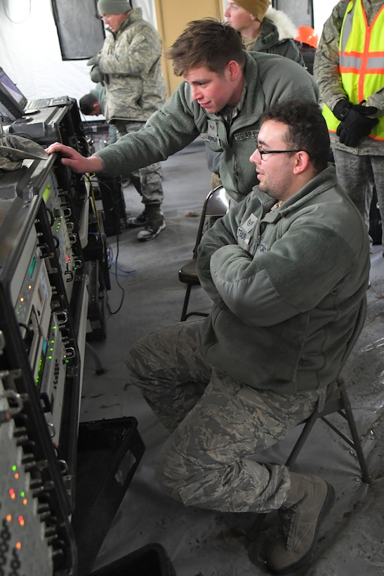 Staff Sgt. Devin Traub (seated) and Senior Airman David Nordin, both 729th Air Control Squadron, monitor communications equipment Feb. 6, 2019, during a readiness exercise at Hill Air Force Base, Utah. The evolution was part of an exercise to mobilize and set up a deployed radar location and control reporting center. (U.S. Air Force photo by Todd Cromar)