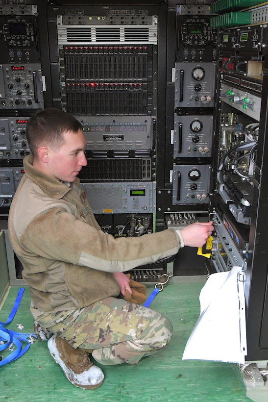 Staff Sgt. Zachary Witt, 729th Air Control Squadron, checks communications equipment Feb. 6, 2019, during a readiness exercise at Hill Air Force Base, Utah. The evolution was part of an exercise to mobilize and set up a deployed radar location and control reporting center. (U.S. Air Force photo by Todd Cromar)