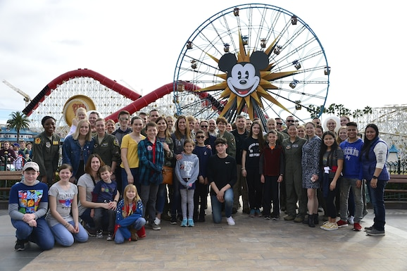 U. S. Air Force and family members together following a F-15C Eagle flyover at California Air National Guard over Disney California Adventure Park in Anaheim, Calif., March 3, 2019.