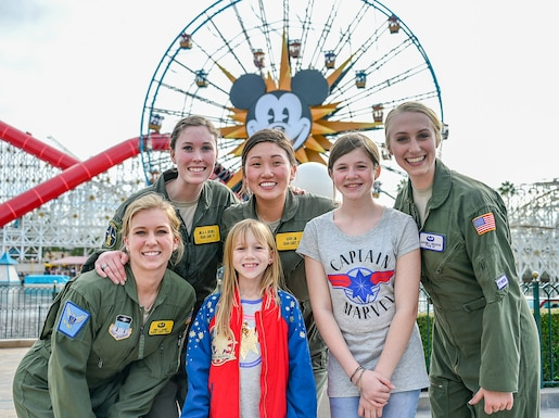 U.S. Air Force Academy cadets pose with theme park visitors following an F-15C Eagle fighter jet flyover at Disney California Adventure Park in Anaheim, Calif., March 3, 2019.