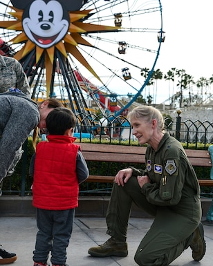 U.S. Air Force Brig. Gen. Jeannie Leavitt talks to a young child about aviation following an F-15C Eagle flyover, performed by the California Air National Guard's 144th Fighter Wing at Disney California Adventure Park in Anaheim, Calif., March 3, 2019.