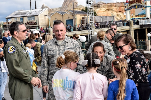 "U.S. Air Force Staff Sgt. Amanda Rubio, 144th Maintenance Group, talks with three excited young theme park visitors about her role in Marvel Studios ""Captain Marvel"" that debuts in theaters on March 8, 2019."