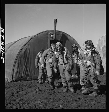 Newman C. Golden, second from right, exits a briefing room along with his fellow Tuskegee Airmen in March 1945 in Ramitelli, Italy. Golden was shot down in 1951 during the Korean War. His body was never recovered and he was presumed dead in 1954. (Library of Congress photo)
