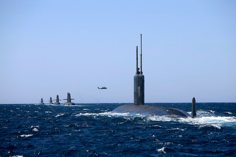 USS Santa Fe (SSN 763) joins Collins Class Submarines, HMAS Collins, HMAS Farncomb, HMAS Dechaineux and HMAS Sheean in formation while transiting through Cockburn Sound, Western Australia.