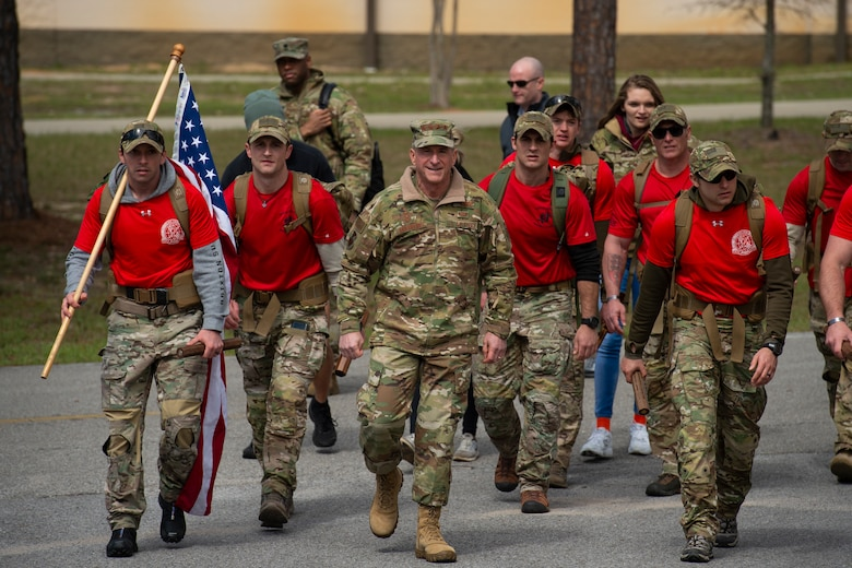Air Force Chief of Staff Gen. David L. Goldfein marches alongside Special Tactics Airmen with the 24th Special Operations Wing during the Special Tactics Memorial March at Hurlburt Field, Florida, March 4, 2018.