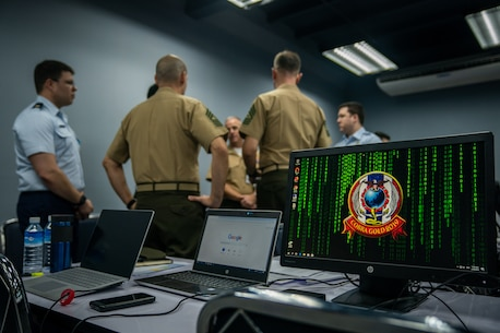 U.S. Marines and U.S. Air Force service members discuss defensive cyber operations during the cyber range as part of exercise Cobra Gold at the Royal Thai Air Force Headquarters in Bangkok, Kingdom of Thailand, Feb. 20, 2019.