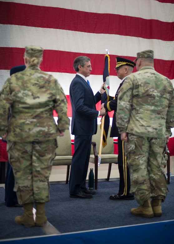 U.S. Army Brig. Gen. Michael Berry receives the Delaware National Guard guideon during a change of command ceremony at the Army Aviation Facility, New Castle, Del., March 2, 2019. After 42 years of distinguished and dedicated service, Timmons will retire from the DNG. (U.S. Air National Guard photo by Senior Airman Katherine Miller)